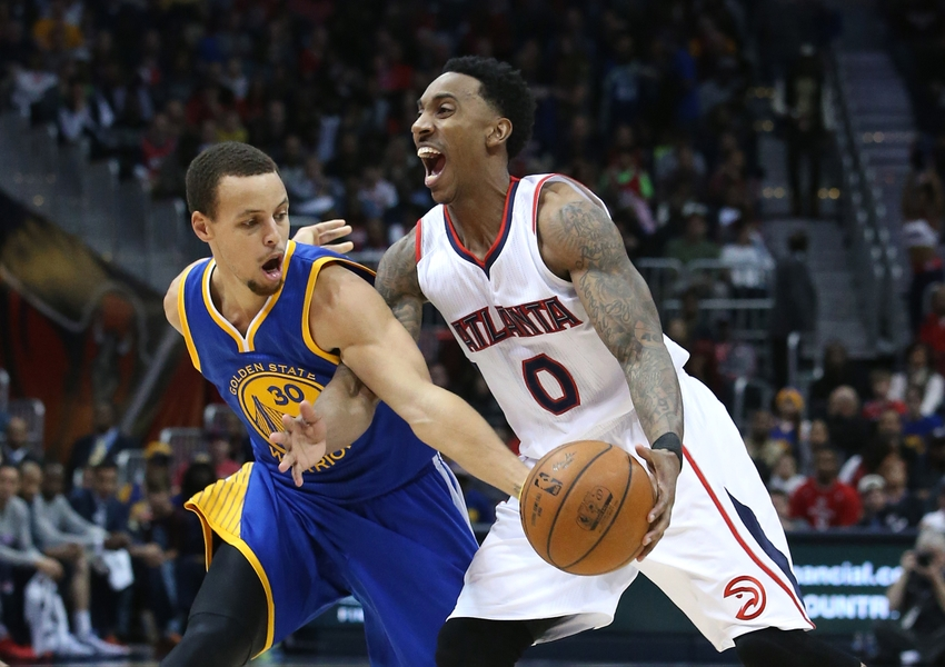 Feb 6, 2015; Atlanta, GA, USA; Atlanta Hawks guard Jeff Teague (0) is fouled by Golden State Warriors guard Stephen Curry (30) on a steal attempt in the third quarter of their game at Philips Arena. The Hawks won 124-116. Mandatory Credit: Jason Getz-USA TODAY Sports