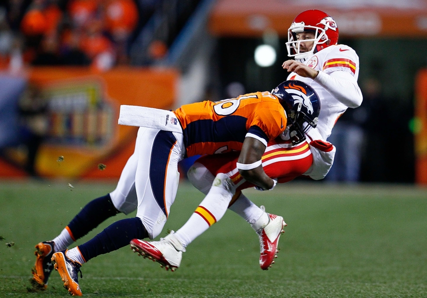 Nov 17, 2013; Denver, CO, USA; Denver Broncos cornerback Kayvon Webster (36) tackles Kansas City Chiefs quarterback Alex Smith (11) in the third quarter at Sports Authority Field at Mile High. The Broncos won 27-17. Mandatory Credit: Isaiah J. Downing-USA TODAY Sports