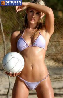 picture of a girl in bikini holding a beach volleyball